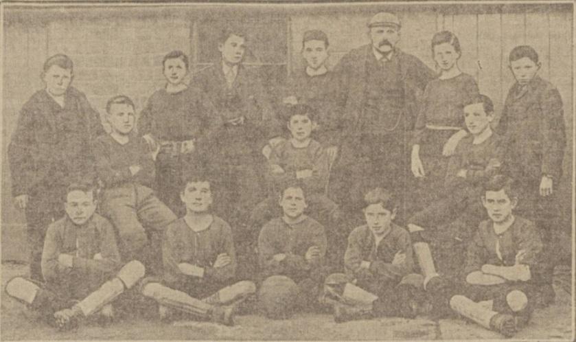 Herbert Craik, back row, standing number 2 from right next to the older gentleman.