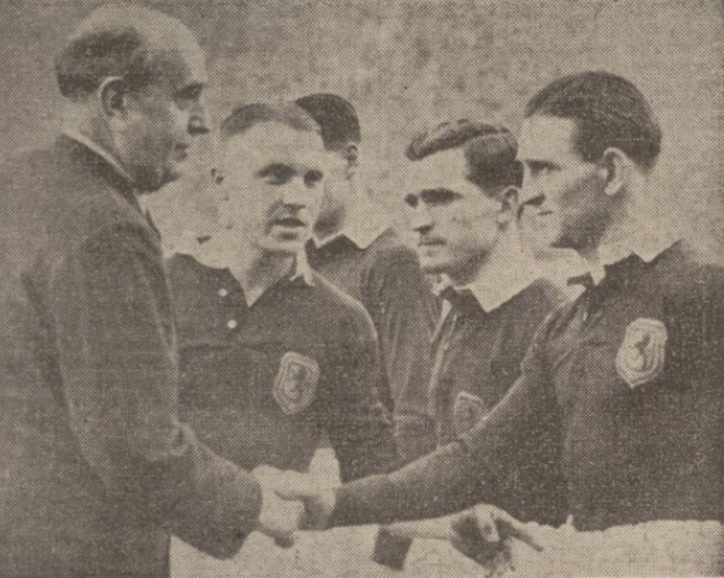 The guest of honour at Hampden meets the Scottish team. Czechosloak Minister of Foreign Affairs, Jan Masaryk, shakes hands with Dougie Wallace. Skipper Shankly does the introducing. Alec enters is also in the picture.