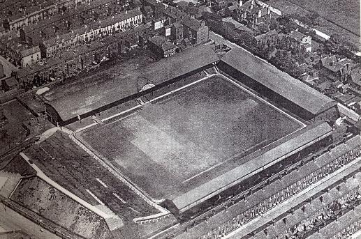 The new Anfield is taking shape. The Kop towards the bottom left corner. the Kemlyn Road, towards the bottom right corner, now consists of the old Main stand.