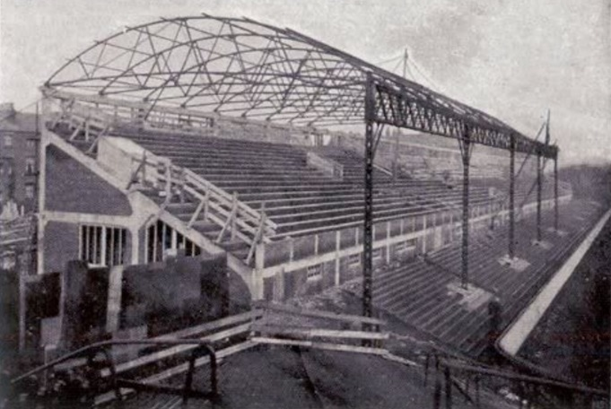 "From a postcard stating ""Main stand."" I am not sure if it is the old main stand that was moved across to Kemlyn Road side, or if it is he new one build in 1906."